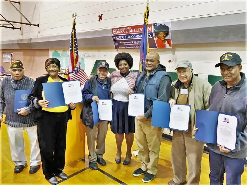 Veterans of six wars – WWII, Korea, Vietnam, Gulf War, Afghanistan and Iraq – gather with Rep. McClinton (center) at the Veterans' Expo Nov. 8 at Myers Rec. Center. Members of all branches of the service were in attendance.