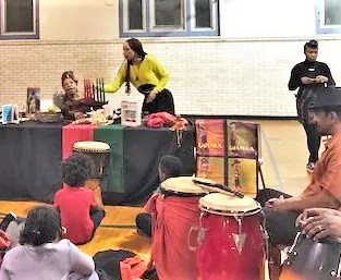 On the right of the lively celebration of Kwanzaa at Kingsessing Rec Center are the Rare Genius drums which added to the meaningful explanation of Black cultural values at the December 27 event.