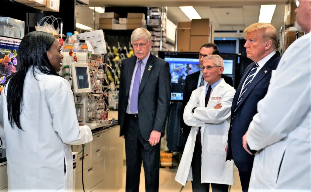 Dr. Kizzmekia Corbett (left) a senior virus researcher with Dr. Anthony Fauci and Pres. Trump.  She has been a central figure in Covid-19 vaccine science.