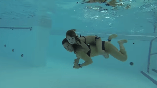 Carla underwater swimming with mom like Mermaids