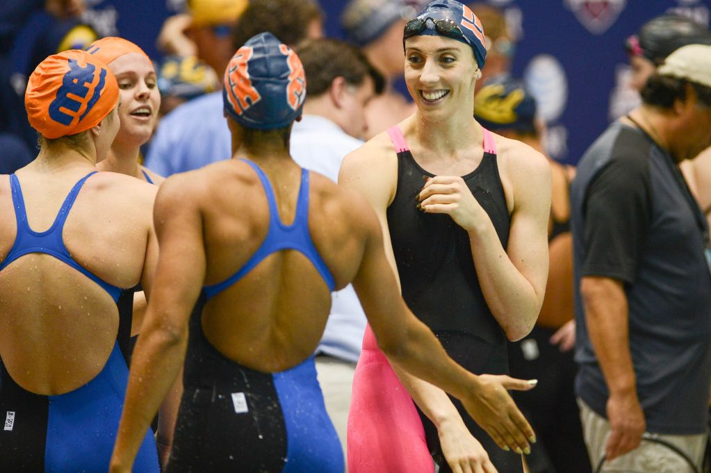 KNOXVILLE, TN - December 5, 2013 - SwimMAC Carolina teammates celebrate after winning the 4x50 Yard Freestyle Relay during the USA Swimming AT&T Winter National Championships at the Allan Jones Aquatic Center in Knoxville, Tennessee