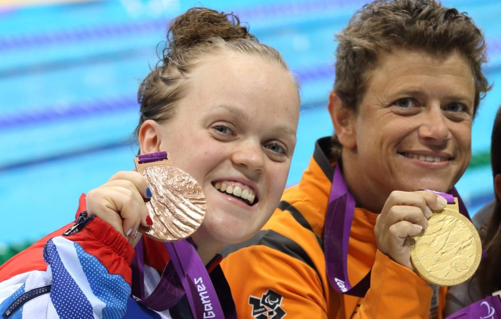 Sep 4, 2012; London, United Kingdom; Victory ceremony of the Women's 50m Freestyle S6 Mirjam de Koning-Peper (NED) with gold, Victoria Arlen (USA) with silver, Ellie Simmonds (GBR) with bronze during the London 2012 Paralympic Games at Aquatics Centre. Mandatory Credit: Paul Cunningham-US PRESSWIRE