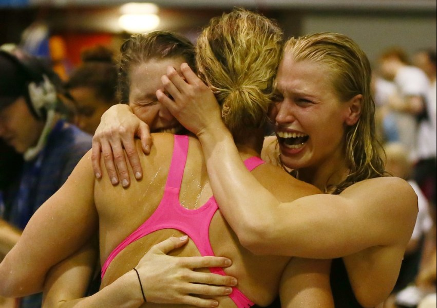 Ellen Quirk and Samantha Lucie-Smith of the NZL Woman's 4 x 100m relay team celebrate with team mate Laura Quilter after qualifying for the Commonwealth Games during Day Four, session eight of the State New Zealand Open Swimming Champs, Westwave Aquatics, Henderson, Auckland, New Zealand. Wednesday 11 April 2014. Photo: Simon Watts/www.bwmedia.co.nz/Swimming New Zealand