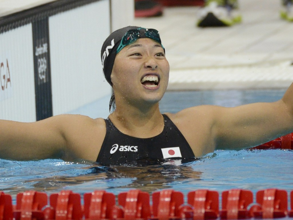 Jul 30, 2012; London, United Kingdom; Satomi Suzuki (JPN) reacts after finishing in third in the women's 100m breaststroke finals during the London 2012 Olympic Games at Aquatics Centre. Mandatory Credit: Richard Mackson-USA TODAY Sports