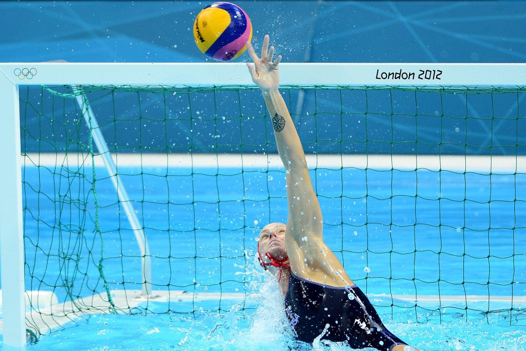 Aug 7, 2012; London, United Kingdom; USA goal keeper Betsey Armstrong (1) tips the ball over the net in overtime against Australia in the women's semifinal in the London 2012 Olympic Games at Water Polo Arena. Mandatory Credit: Andrew Weber-USA TODAY Sports