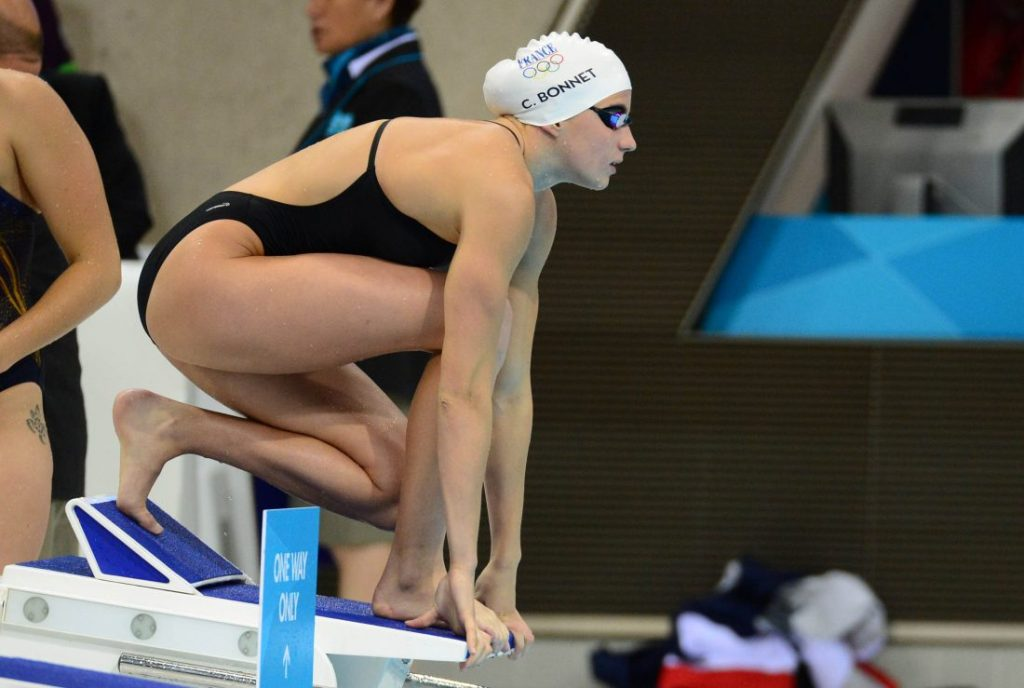 Jul 29, 2012; London, United Kingdom; Charlotte Bonnet (FRA) prepares to dive off the starting blocks in a warm up session during the London 2012 Olympic Games at Aquatics Centre. Mandatory Credit: Kyle Terada-USA TODAY Sports