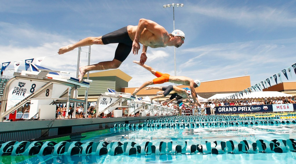 Apr 25, 2014; Mesa, AZ, USA; Michael Phelps dives into the pool for the 50m freestyle prelims during the Arena Grand Prix at Skyline Aquatic Center. Mandatory Credit: Rob Schumacher-USA TODAY Sports