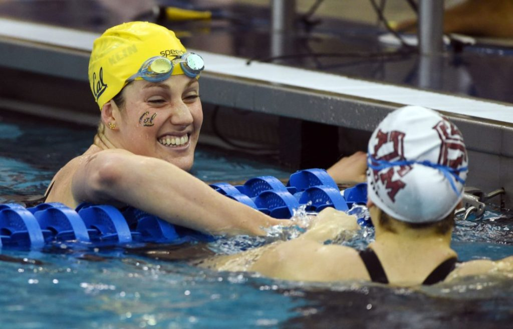 Mar 21, 2015; Greensboro, NC, USA; Missy Franklin and Beryl Gastaldello congratulate each other after swimming in 400m freestyle relay during NCAA Division I Swimming and Diving-Championships at Greensboro Aquatic Center. Mandatory Credit: Evan Pike-USA TODAY Sports