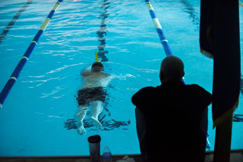Lt. Shannon Scaff, an instructor at the Coast Guard Maritime Law Enforcement Academy in Charleston, S.C., takes a lap during a long distance swim he dedicated to a fallen Coast Guard aircrew, Feb. 27, 2015. Scaff undertook the challenge of swimming in a local Charleston pool for 24 hours to bring awareness and support to the families of fallen military members. (U.S. Coast Guard photo by Petty Officer 1st Class Stephen Lehmann)
