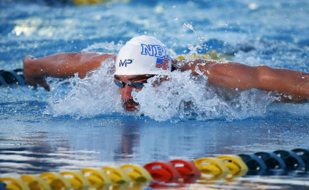 Apr 16, 2015; Mesa, AZ, USA; Michael Phelps wins the Men's 100 meter butterfly final in 52.92 seconds during the 2015 Arena Pro Swim Series at the Skyline Aquatic Center. Mandatory Credit: Rob Schumacher/Arizona Republic via USA TODAY Sports