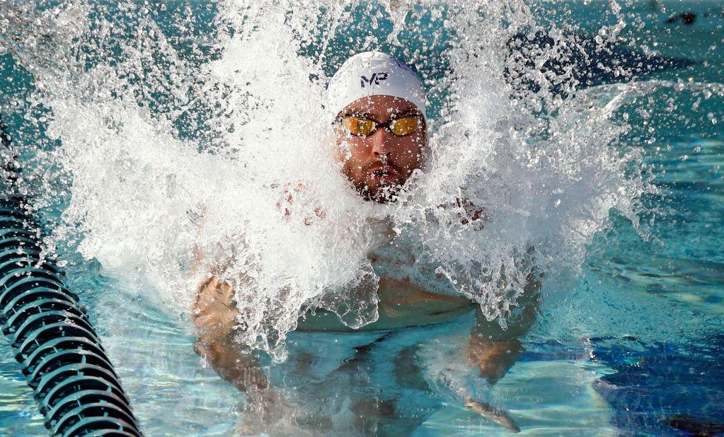Apr 16, 2015; Mesa, AZ, USA; Michael Phelps jumps into the practice pool as he prepares for the Men's 100 meter butterfly final during the 2015 Arena Pro Swim Series at the Skyline Aquatic Center. Mandatory Credit: Rob Schumacher/Arizona Republic via USA TODAY Sports