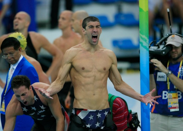 Michael Phelps, right, and Garrett Weber-Gale, both of the U.S., react after winning the men's 4X 100-meter freestyle relay swimming event on day three of the 2008 Beijing Olympics in Beijing, China, on Monday, Aug. 11, 2008.