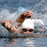 Jul 12, 2015; Toronto, Ontario, CAN; Eric Hedlin of Canada leads a pack of swimmers in the men's open water swim during the 2015 Pan Am Games at Ontario Place West Channel. Mandatory Credit: Erich Schlegel-USA TODAY Sports