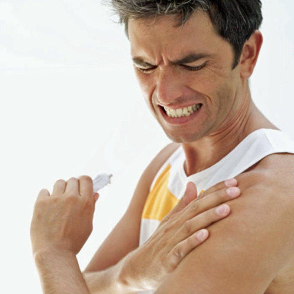 Man with hurt shoulder