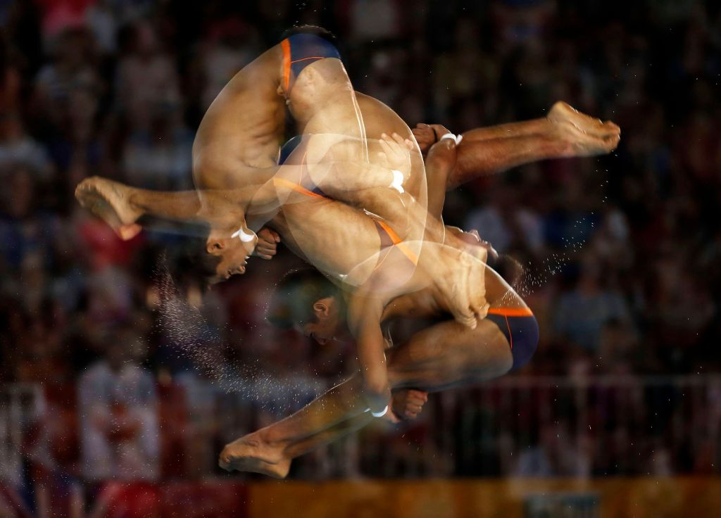 Jul 13, 2015; Toronto, Ontario, USA; (editors note: multiple exposure function used in the creation of this image) Jonathan Ruvalcaba of Mexico competes in the men's 10m platform during the 2015 Pan Am Games at Pan Am Aquatics UTS Centre and Field House. Mandatory Credit: Rob Schumacher-USA TODAY Sports