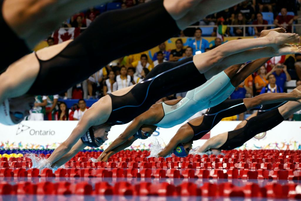 Jul 17, 2015; Toronto, Ontario, CAN; Arianna Vanderpool-Wallace of the Bahamas dives into the pool at the start of the women's 50m freestyle final the 2015 Pan Am Games at Pan Am Aquatics UTS Centre and Field House. Mandatory Credit: Rob Schumacher-USA TODAY Sports