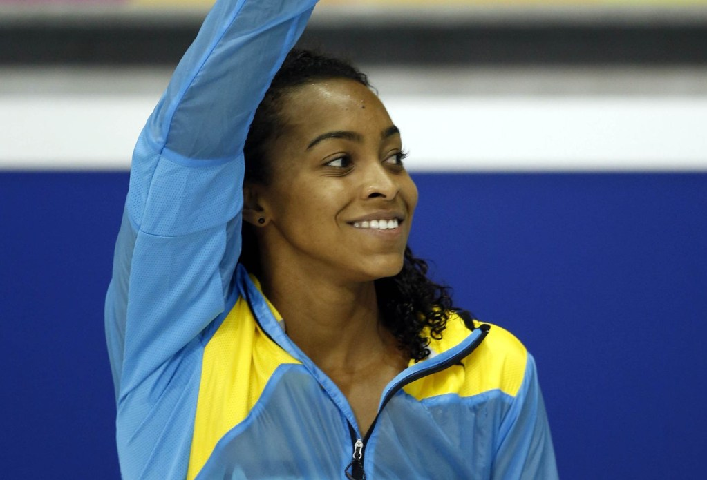 Jul 17, 2015; Toronto, Ontario, CAN; Arianna Vanderpool-Wallace of the Bahamas celebrates on the podium after winning the women's 50m freestyle final the 2015 Pan Am Games at Pan Am Aquatics UTS Centre and Field House. Mandatory Credit: Erich Schlegel-USA TODAY Sports