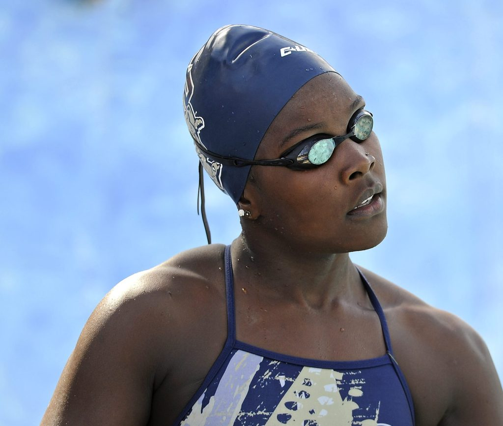 30 January 2016: FIU's Naomi Ruele prepares to compete in the 100 yard freestyle as the FIU Golden Panthers faced the University of Miami Hurricanes at the Biscayne Bay Campus Aquatics Center in Miami, Florida.
