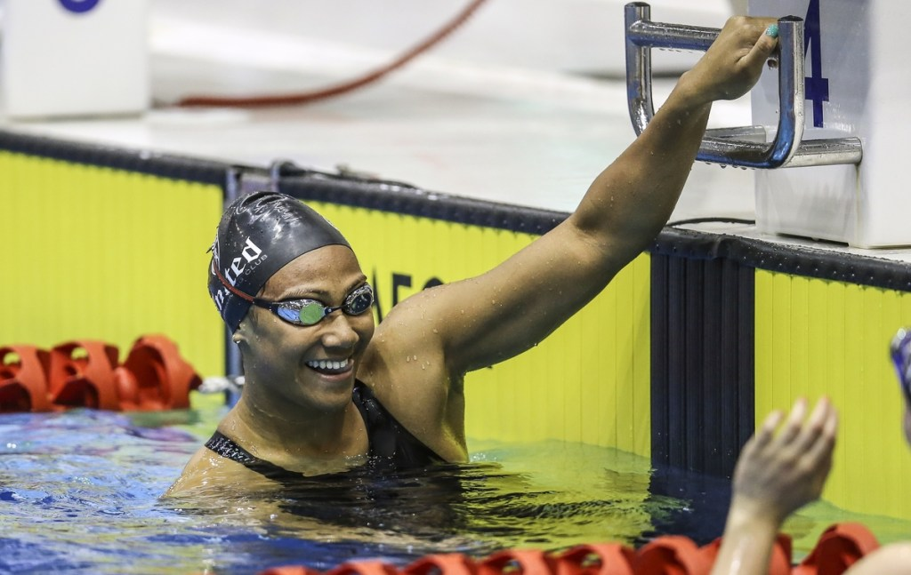 Gabrielle Fa'amausili celebrates a Junior PanPac qualifying time in the 100m backstroke during the Swimming NZ, National Age Group Championships, Wellington Regional Aquatic Centre, Kilbirnie, Wellington, Tuesday 19 April 2016. Photo: Simon Watts/www.bwmedia.co.nz