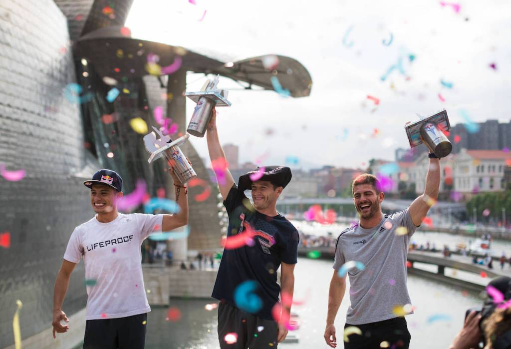 Second placed Jonathan Paredes (L) of Mexico and winner Steven LoBue (C) and third placed David Colturi of the USA celebrate on the podium during the final competition day of the second stop at the Red Bull Cliff Diving World Series in Bilbao, Spain on June 30, 2018. // Romina Amato/Red Bull Content Pool // AP-1W4UMUDJD2111 // Usage for editorial use only // Please go to www.redbullcontentpool.com for further information. //