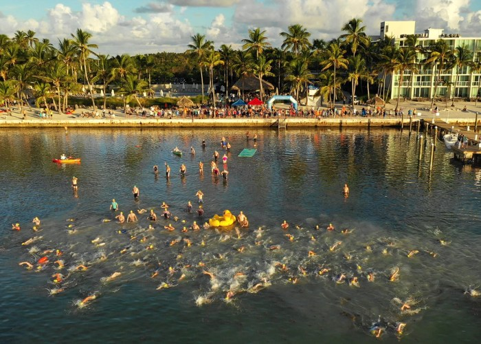 """A portion of a field of more than 350 swimmers begins the """"Swim for Alligator Lighthouse Saturday, Sept. 15, 2018, off Islamorada, Fla. Entrants, divided into single and group divisions, navigated an 8-mile open water swimming course from the Amara Cay Resort in the Florida Keys to Alligator Reef Lighthouse and back. FOR EDITORIAL USE ONLY (Bob Care/Florida Keys News Bureau/HO)"""