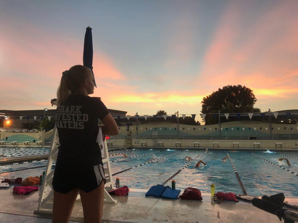 standing-on-pool-deck-sunrise
