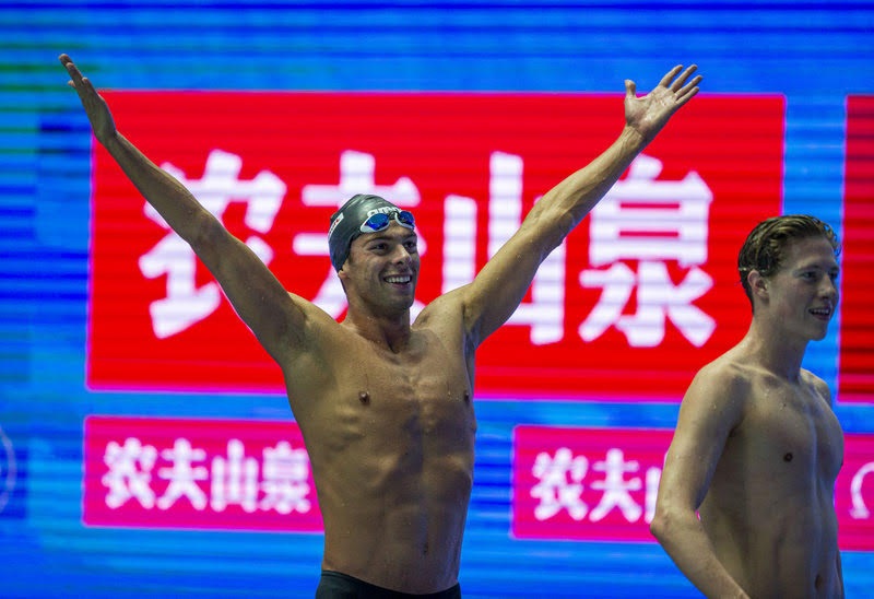 Gregorio Paltrinieri of Italy celebrates on his way out after winning in the men's 800m Freestyle Final during the Swimming events at the Gwangju 2019 FINA World Championships, Gwangju, South Korea, 24 July 2019. Henrik Christiansen of Norway (R) finishes second.
