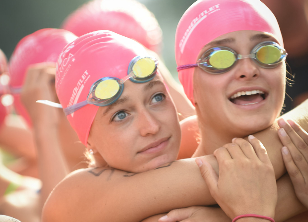 girls-in-pink-caps-and-goggles-hug