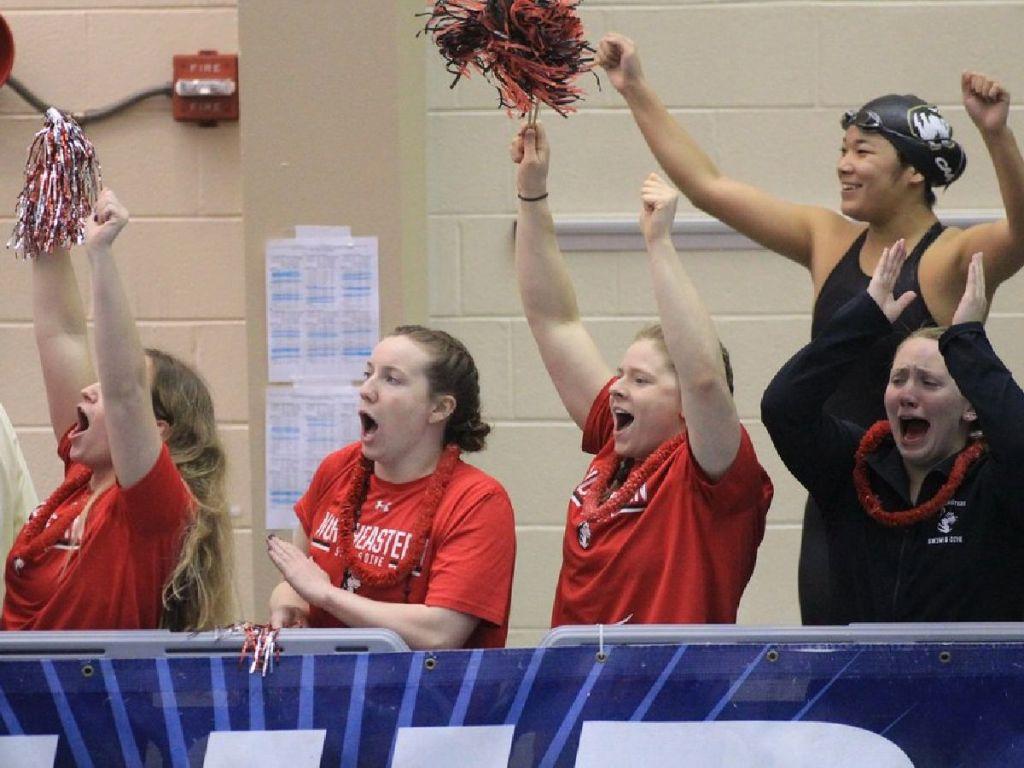 northeastern huskies team cheer celebrate teammates
