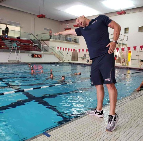 Brett Hawke teaching at a swim camp