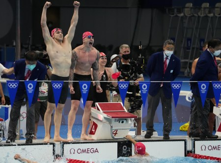 Jul 31, 2021; Tokyo, Japan; James Guy (GBR) and Adam Peaty (GBR) celebrate victory in the mixed 4x100m medley relay final during the Tokyo 2020 Olympic Summer Games at Tokyo Aquatics Centre. Mandatory Credit: Rob Schumacher-USA TODAY Sports