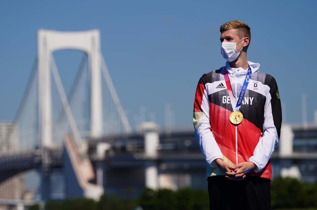 Aug 5, 2021; Tokyo, Japan; Florian Wellbrock (GER) wears his gold medal after the men's 10km marathon swimming competition during the Tokyo 2020 Olympic Summer Games at Odaiba Marine Park. Mandatory Credit: Kareem Elgazzar-USA TODAY Sports