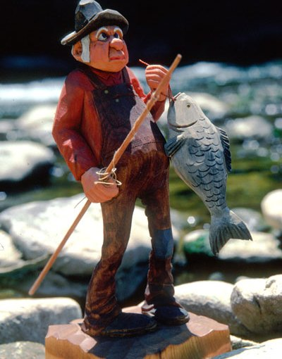 Ozark woodcarving of fisherman