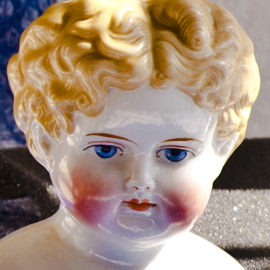Blonde china head doll