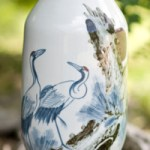Cranes and traditional art painted on sake jug and signed by artist