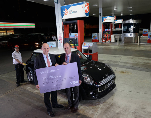 Peter Morris, Chevron Philippines Inc. Country Chairman and General Manager for  Philippine products and Stuart Tomlinson, Visa Country Manager for the Philippines  and Guam officially launch the Caltex-Visa Mini Promo.