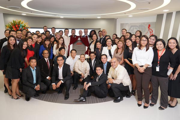 ADP Philippines associates and leaders celebrate the inauguration of the company's expansion in Aeon Centre, Alabang