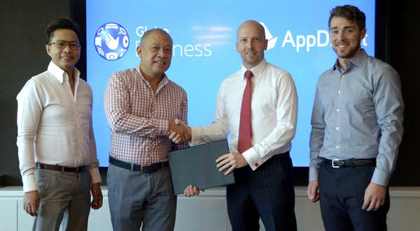 Globe President and CEO Ernest Cu (2nd from left) seals the agreement with AppDirect Regional Director for Asia Lincoln Jack Lincoln (2nd from right) to offer Philippine enterprises and SMEs cloud-based applications via the Globe AppMarket. Joining them are Globe IT Enabled Services Group VP for Sales Rey Lugtu and AppDirect Senior Account Manager for North America Chris Messick.