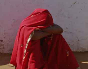 Krishna breaks down after her husband Gopal came home drunk in a village near Baran