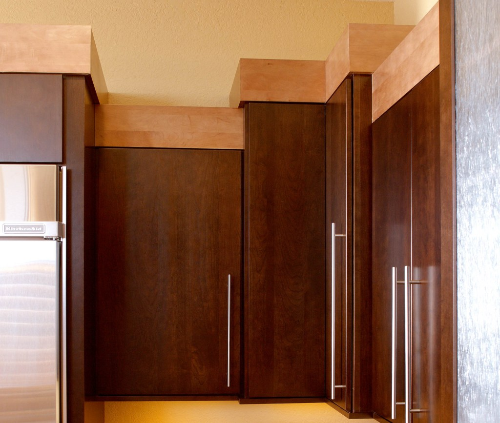 Cherry cabinets with simple maple crownmolding and sleek bar pulls.Cherry cabinets with simple maple crownmolding and sleek bar pulls.