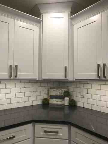 White cabinets with subway tile backsplash and Cambria quartz