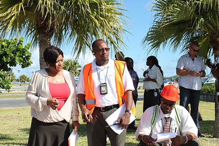 SXM Airport Managing Director Regina LaBega (L) and Manager of Operations Michel Hyman (2nd L) outside of airport building during previous evacuation drill. (SXM photo)