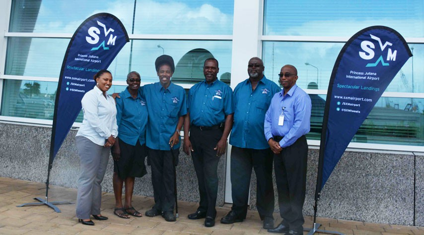 In Photo: ATA Secretary Rohan Romney and President Jean Samuel (center) pose with other ATA members in the new SXM branded uniforms. They are joined by Maggie Gumbs, SXM  Airport Marketing Officer (left) and Larry Donker, SXM Director of Operations (right).