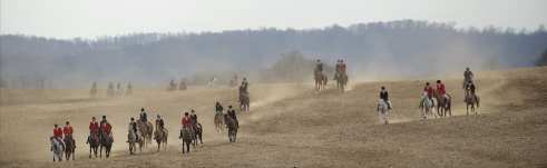 First and second flights at a gallop over cultivated field. William Kenner