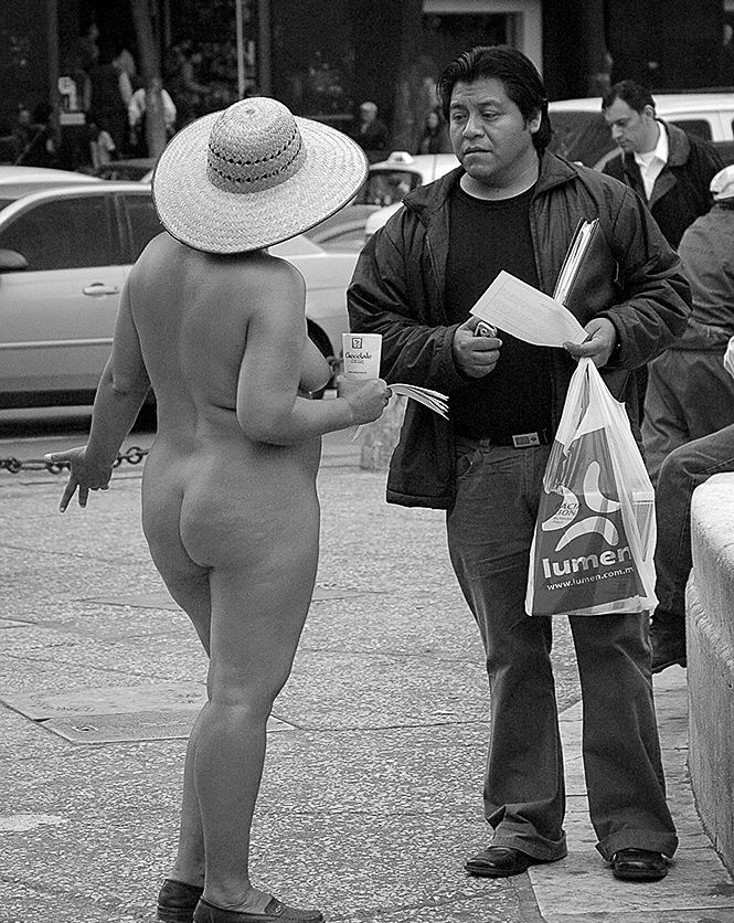 The Conversation ©Owen Murphy The woman was part of a large group of protestors who arrived every day to stand around the plaza in front of the Palacio de Bellas Artes in Mexico City. A governor of one of the states had defrauded the campesinos from many villages and to bring the fact to light and seek compensation they chose to stand naked, hand out information sheets and chant to anyone who passed by. The men wore small placards with the governor's face over their genitals while the women, in one of the most modest countries imaginable, stood completely without clothes.