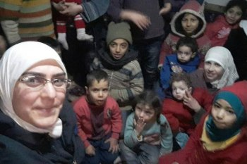 بيان ريحان، وهي رئيسة مكتب المرأة في لجنة التنسيق المحلية بمدينة الغوطة الشرقية في دوما