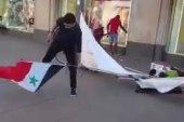 شاب سوري يدعس على علم النظام السوري في برلين الألمانية