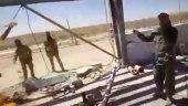 مقاتلون روس يقطعون مواطنًا سوريًا.. والائتلاف يطالب بمحاسبة المجرم الأكبر