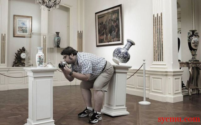 Photographer knocking over vase while taking picture
