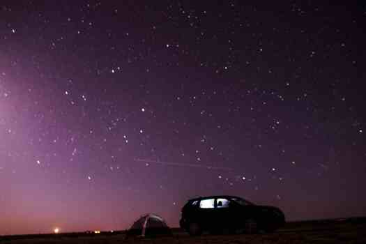 Our 2-person tent against the backdrop of a beautifully lit night sky in Williams, Arizona